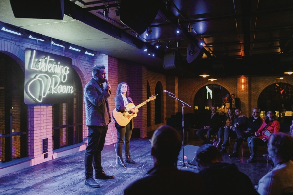 From left: Listening Room General Manager and Talent Buyer Quinn Mathews and Katie Pillsbury of The Crane Wives onstage at Listening Room.