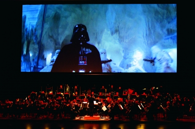 "The Kalamazoo Symphony Orchestra playing alongside ""Empire Strikes Back."""